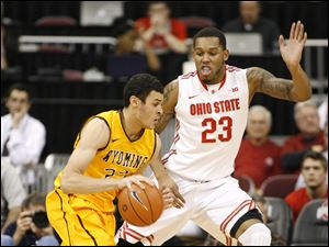 Ohio State's Amir Williams (23) guards Wyoming's Lary Nance, Jr. (22) during the first half of an NCAA college basketball game, Monday, Nov. 25, 2013, in Columbus, Ohio. (AP Photo/Mike Munden)
