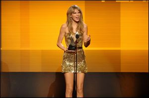 Taylor Swift accepts the award for favorite country female artistat the American Music Awards  on Sunday in Los Angeles.