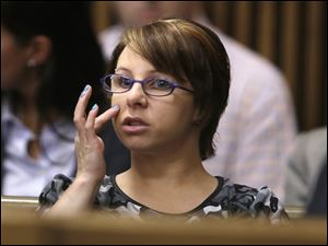 Michelle Knight sits in the courtroom during a break in the sentencing phase for Ariel Castro, in Cleveland in August.