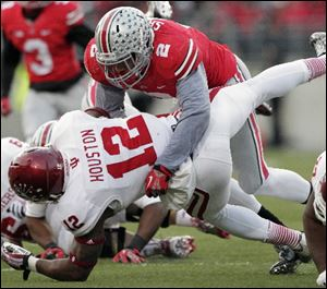 Ohio State linebacker Ryan Shazier, top, tackles Indiana running back Stephen Houston during the Buckeye's game on Saturday.
