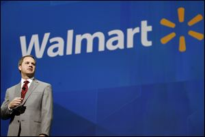 Doug McMillon, President and CEO, Wal-Mart International, speaks at the shareholders meeting in Fayetteville, Ark., in June.