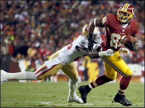 Washington Redskins wide receiver Pierre Garcon is tackled by San Francisco 49ers defensive back Tramaine Brock during the first half of an NFL football game in Landover, Md., Monday.