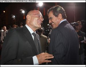 Producer Arnon Milchan, left, and C.O.O. and President of News Corporation Peter Chernin arrive at