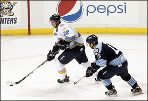 The Walleye's Russ Sinkewich takes control of the puck.