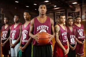 The returners to the Scott basketball team this season, from left: Chris Darrington, Jay Wells, Tray Brown, Percy Bogan, Chris Harris, Larry Green, and Malik Brooks.