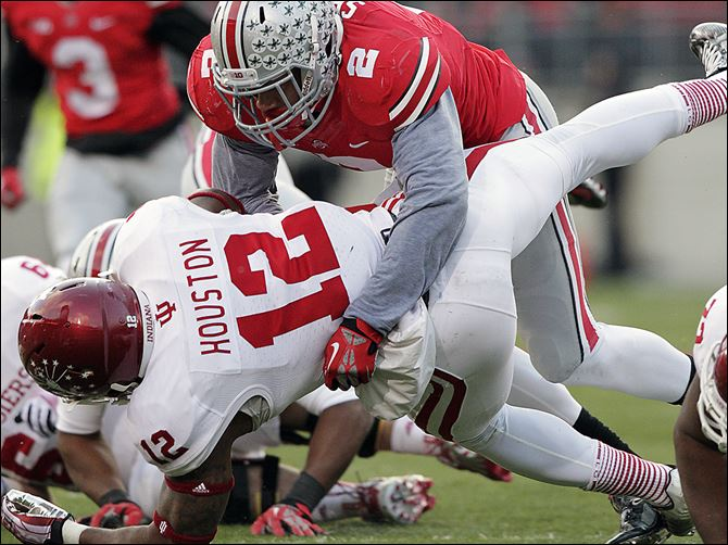 s4tackle-1 Ohio State linebacker Ryan Shazier tackles Indiana running back Stephen Houston during the second quarter on Saturday. The junior defensive leader had 20 tackles in Ohio State's rout of Indiana.