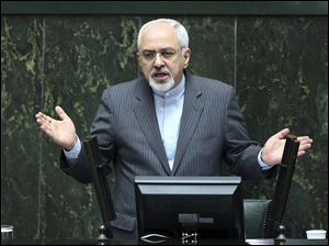 Iranian Foreign Minister Mohammad Javad Zarif speaks in the parliament in Tehran, Iran today. He and President Rouhani must convince skeptics that they are not compromising on key issues of national sovereignty.