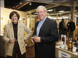 Stephanie Streeter, Libbey chief executive, and Richard Reynolds, the most senior member of the management team, appear at an open house for his retirement at Libbey's factory showroom.