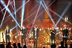 From left, Zayn Malik, Liam Payne, Harry Styles, Louis Tomlinson, and Niall Horan of the musical group One Direction perform on stage at the American Music Awards on Sunday.
