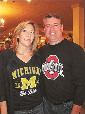Andrea and Pat Gibbons root for opposing teams.