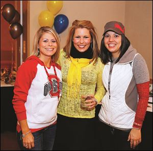Left to right Allison Hammons, Cheryl Hardy, and Sheri Bokros during the Epilepsy Center tailgate party.