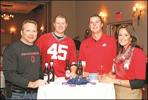 Left to right Rod Bowe, Dan Diekman, Ryan Heckel, and Stacy Heckel during the Epilepsy Center tailgate party Thursday, 11/14/13, at the Hilton Garden Inn in Perrysburg, Ohio.