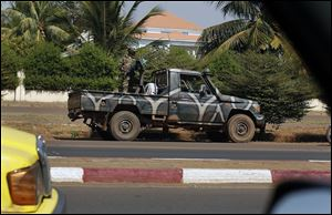 A Malian military vehicle guards the vicinity of the house of Gen. Amadou Haya Sanogo in Bamako, Mali