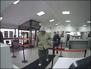 The suspect is described as a white male, 50s to 60s in age. He was approximately 6 foot, or slightly taller, with a medium build. He was wearing a tan coat, gray hooded sweatshirt, dark gray pants, white tennis shoes, and sunglasses. The man had gray facial hair estimated to be only a few days old.