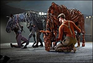 Joey and Topthorn graze in a scene from 'War Horse.'