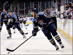 Walleye's Trevor Parkes (27) moves the puck against South Carolina.