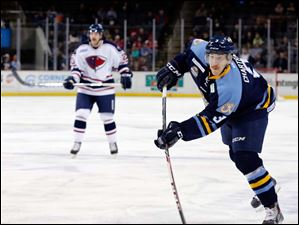 Walleye's C.J. Chartrain (3) takes a shot on goal against South Carolina.