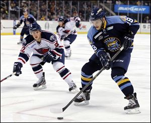 Walleye's Martin Frk (19) moves the puck against South Carolina during an ECHL hockey game Wednesday.