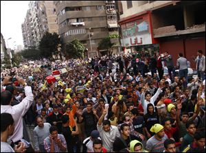 Supporters of Egypt's ousted President Mohammed Morsi hold a rally against a new law regulating protest in Cairo, Egypt, today.