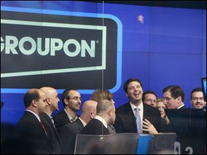Andrew Mason, founder and chief executive of Groupon, attends