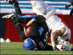 Buffalo quarterback Joe Licata is sacked by Bowling Green' Paul Swan on Friday during the second quarter at Ralph Wilson Stadium.