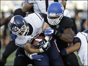Buffalo linebacker Khalil Mack, right, tackles Connecticut running back Max DeLorenzo (44) during a game in Buffalo, N.Y. in September. Mack is the leader of a Buffalo defense that allows just 22.2 points per game, second only to the Falcons (14.4).