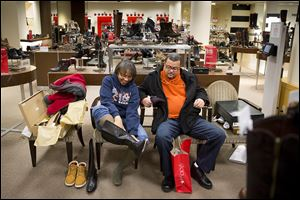 Lorice and Marc Pullins of Chicago shop for shoes on Black Friday at Macy's  in Chicago. Black Friday savings also attract 'self-gifters,' people who jump on two-for-one deals to buy items for themselves.