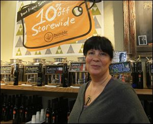 Stephanie Harmon, owner of Bumble Olive Oil Company at the Franklin Park Mall. The shop opened at five a.m., allowing all employees to have Thanksgiving Day off from work.