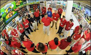 Chuck Weidner, manager at Toys R  Us in York, Pa., center, gives a pep talk to employees before the store opens up for Black Friday shopping on Thursday.