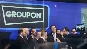 Andrew Mason, founder and chief executive of Groupon, attends his company's IPO in New York. Groupon, the company that pioneered online group discounts, saw its stock climb nearly a third in its public debut in 2011, but the company's share price has been cut by half in the past two years.