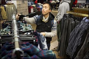 Kevin Zeng of Milwaukee, Wis., shops for clothing on Black Friday at Macy's in Chicago.