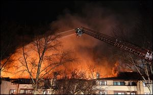 Firefighters battle flames at the Brandywine condominium com-plex in November, 2012, in Monclova Township.