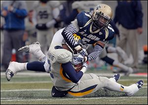 Akron linebacker Justin March sacks Toledo quarterback Terrance Owens in the second quarter.