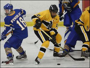 Sylvania Northview's Yaseen Mustapha (10) moves the puck against Findlay during the Cold Turkey Hockey Tournament Saturday, at Tam O Shanter in Sylvania, Ohio.