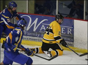 Northview's Josh Koback (21)  moves the puck against Findlay.
