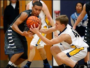 Lake's Brandyn Neal (23) battles Toledo Christian's Ian Gibson (42) for control of the ball.