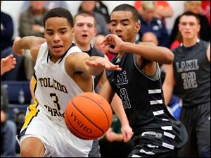 Toledo Christian's Garshawn Paynther (3) and Lake's Brandyn Neal (23) chase a loose ball.