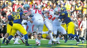 Ohio State running back Carlos Hyde scores the final touchdown for the Buckeyes against Michigan. Hyde ran for 226 yards against the Wolverines, a school record for the UM game.