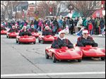 Zenobia Lancers drive in the Home for the Holidays Parade, organized by Downtown Perrysburg Inc.