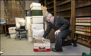 Dave Mittelstaedt packs up books in his office at the Spitzer Building. He practiced law there for 30 years and valued having other lawyers nearby if he had questions.