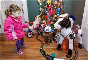 Rhea Ellis-Boone, 2, of Toledo is drawn to a children's display at Mansion View Inn, 2035 Collingwood Blvd.