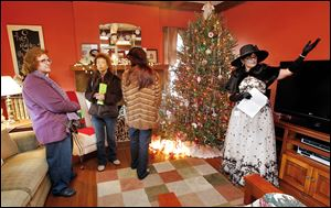 Anita Jacobs, left, Rocky Challen, and Tiffany Densic are given a tour by volunteer Crystal Jordan at 2636 Parkwood Ave. Volunteers at each of the seven homes and a church on the tour offered a historical background of each structure.