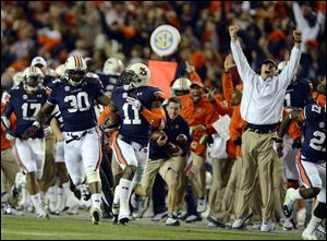 Auburn cornerback Chris Davis (11) returns a missed field-goal attempt more than 100 yards for a touchdown on the final play against Alabama in Auburn, Ala..