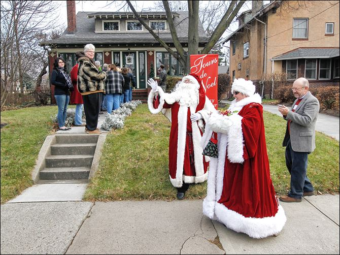 02n2tourssanta-2 Gary Douglass as Santa and Ellen Langel as Mrs. Claus  greet guests lined up outside the home at 2636 Parkwood Ave. during the annual Tours de Noel through the Old West End.
