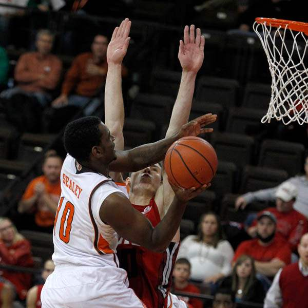 BGSU-s-Craig-Sealey-is-guarded-by-Western-Kentucky-s-Aleksej-Rostov