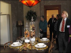 Bill Frisk, right, looks around the dining room at the 2702 Parkwood Ave. home.