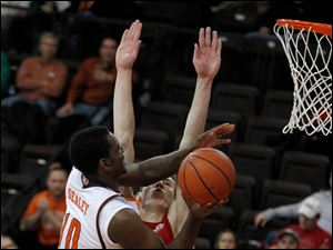BGSU's Craig Sealey is guarded by Western Kentucky's Aleksej Rostov.