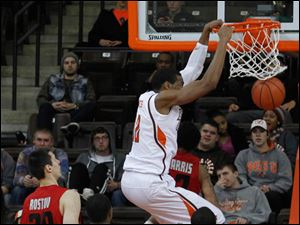 BGSU's Richaun Holmes dunks over Western Kentucky's Aaron Adeoye, 11, during 2nd half.
