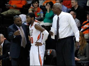 Player Jehvon Clarke gets advice from his coaching staff.