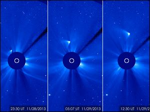 In this combination of three images provided by NASA, comet ISON appears as a white smear heading up and away from the sun on Thursday and Friday.